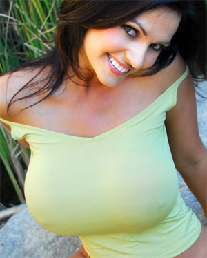 Denise Milani busty in a green dress