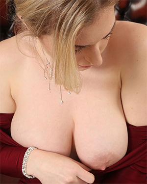 Jenny James red dress cleavage
