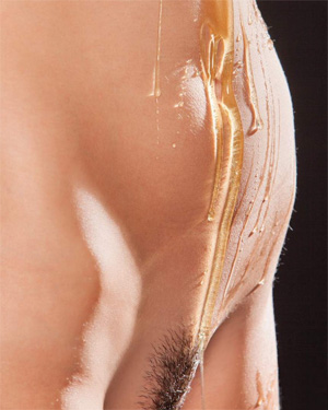 Nude covered in honey