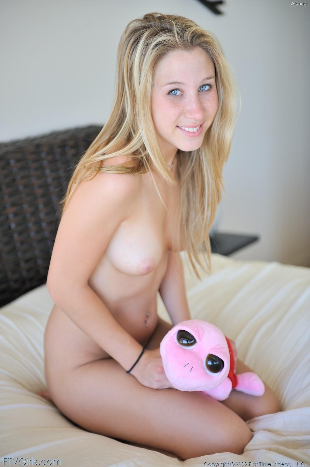 busty nude teen sitting
