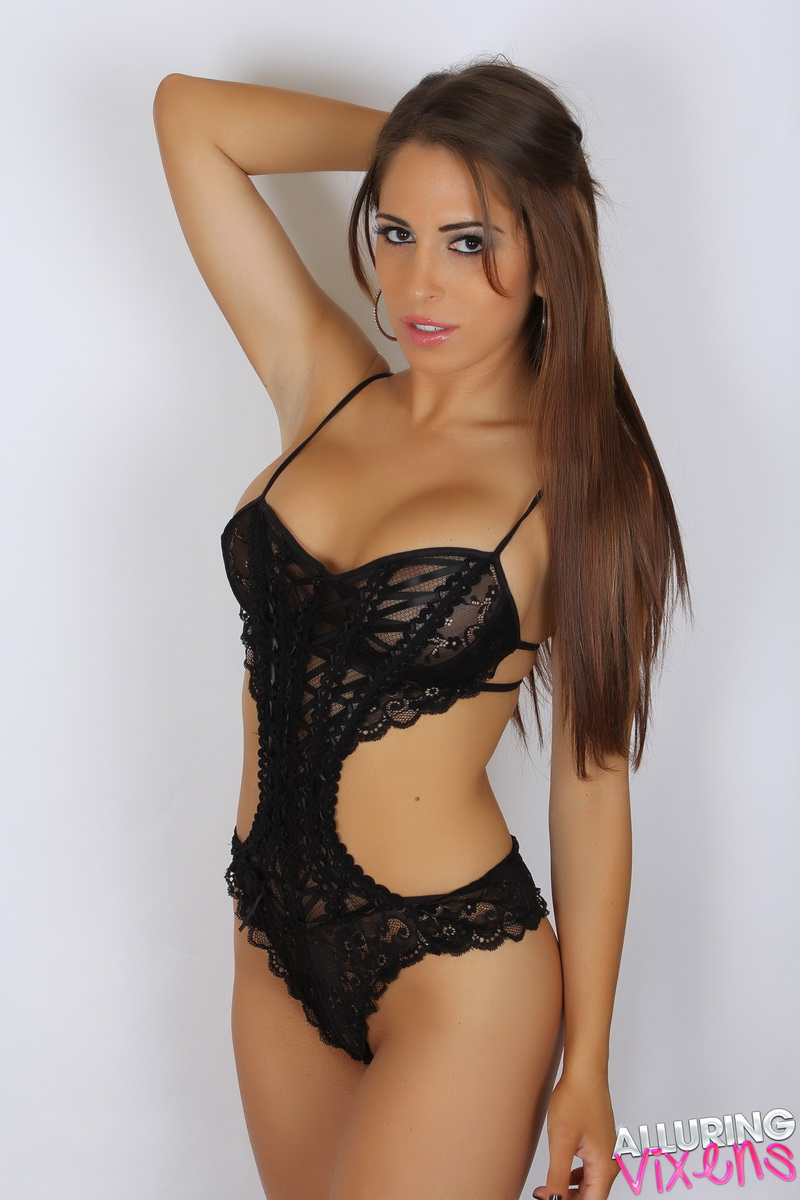Slightly sheer with strategically placed lace for just the right amount of coverage. Made of nylon, polyester and spandex. Stretch mesh body with decorative embroidered lace V-panel at front.