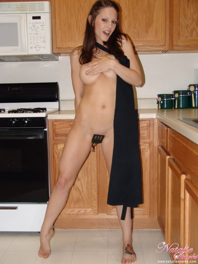 Cooking nude with apron on
