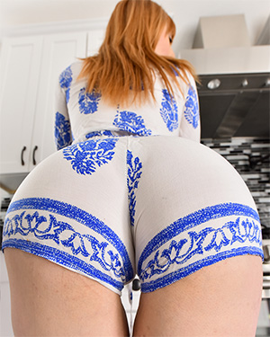 Lauren Phillips tight one piece in the kitchen