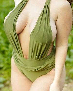 Sophie Dee wears a sexy one piece outside