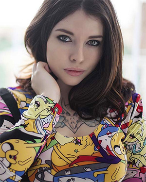 Voly is a colorful and nerdy suicidegirl